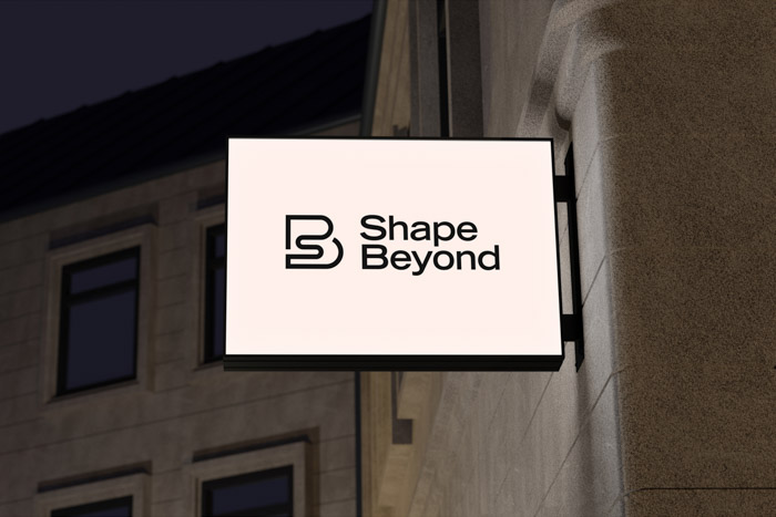 Shape Beyond logo visualised on an outdoor office sign.