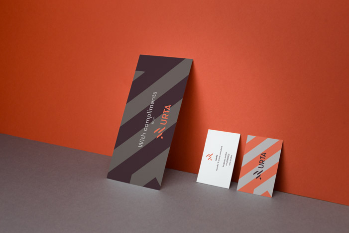Comp slips and business cards for URTA feature geometric artwork made up from the logo mark and a clean typographic style.