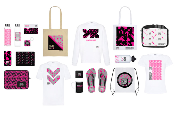 An arrangement of YR Live garments and other products printed with various on-brand graphics to showcase capabilities