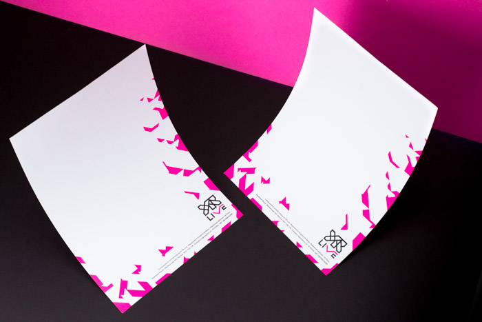 YR Live letterheads designed with typographic elements and hot pink shard pattern along the right and bottom edges.