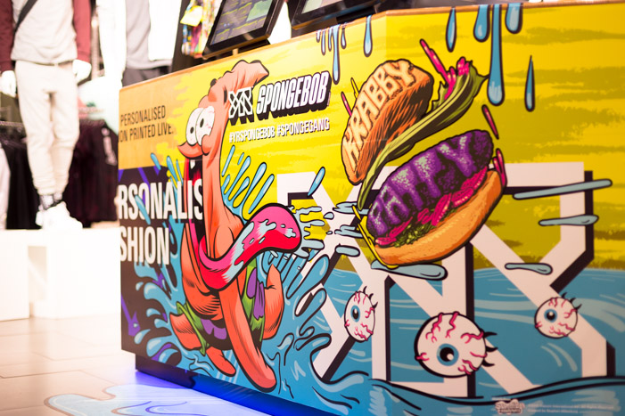 Close-up photo of counter vinyls emphasising the integration of previous YR Store design combined with new SpongeBob themed art.