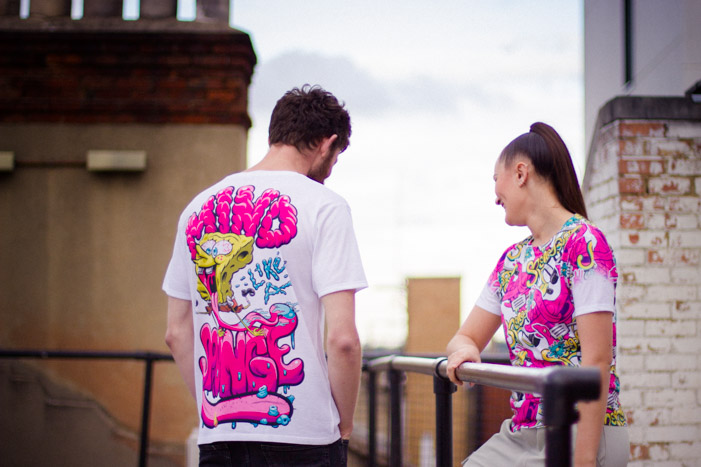 Lifestyle shot of YR Store t-shirts with 'Mind like a sponge' and SpongeBob spatula artwork on a rooftop in Shoreditch.