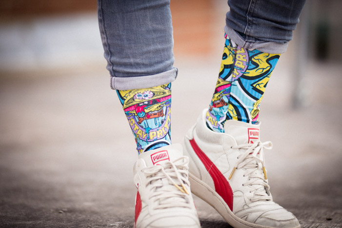 Close-up of YR Store socks with 'Stay Pretty' SpongeBob artwork.