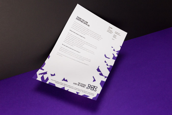 Front of the YR Store letterhead with a structured and clean typographic layout and purple shards across the right and bottom edges.